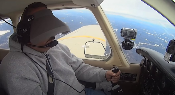 a student flying under the hood during an ipc check