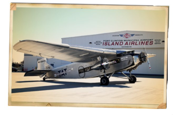 island airlines ford trimotor sits on the airport apron