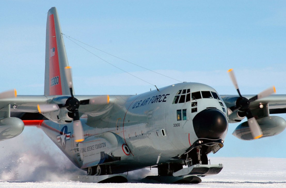 a c-130 outfitted with ski landing gear lands in antarctica