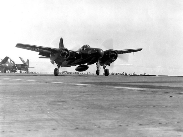 a marine corps F7F-3N tigercar launches from the deck of USS Tarawa