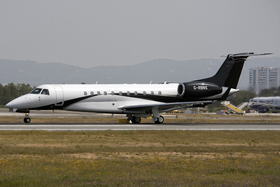 an erj 135 business jet taxis at faro airport in portugal